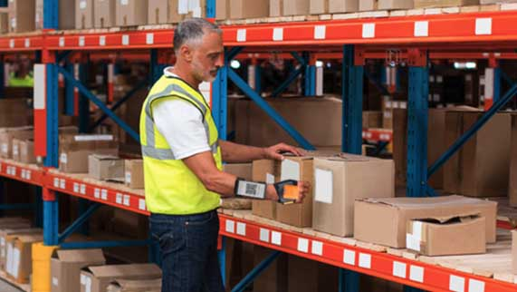 Warehouse Worker Using Hands-Free Barcode Scanner